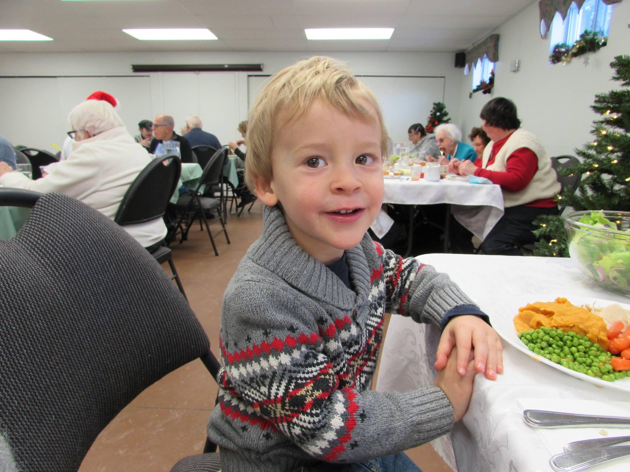 simon enjoying christmas dinner at Saint Alban's